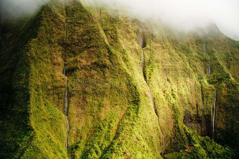 Kauai Mt. Waialeale waterfalls in rain stock photos