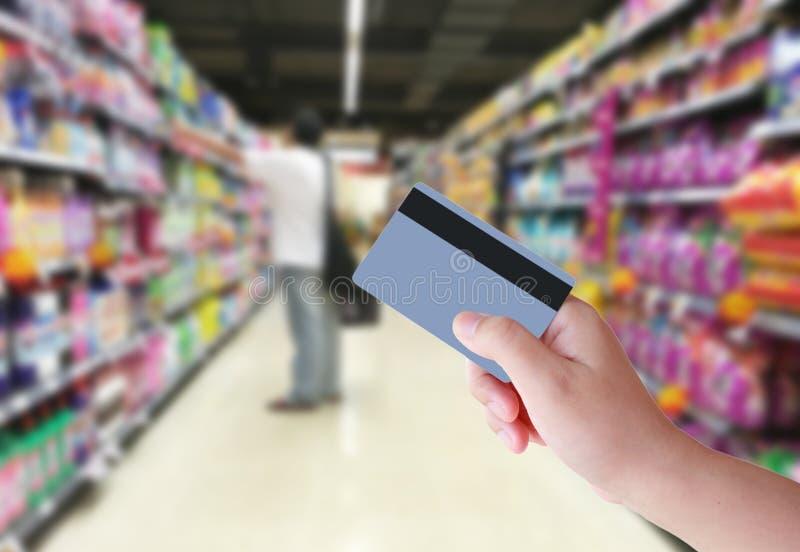 Kaufen mit Kreditkarte stockbild