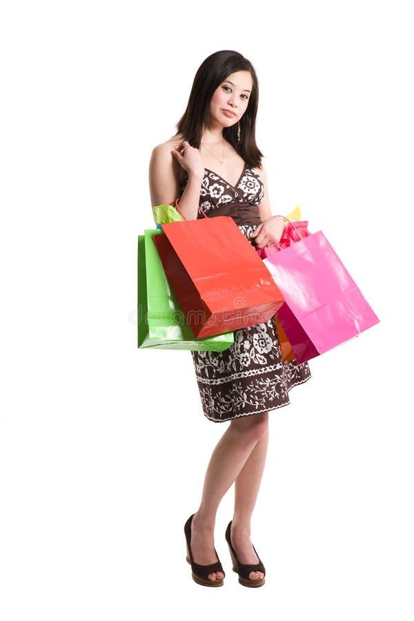 Kaufende asiatische Frau stockbild