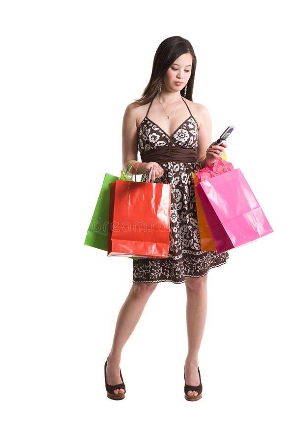 Kaufende asiatische Frau stockfotos