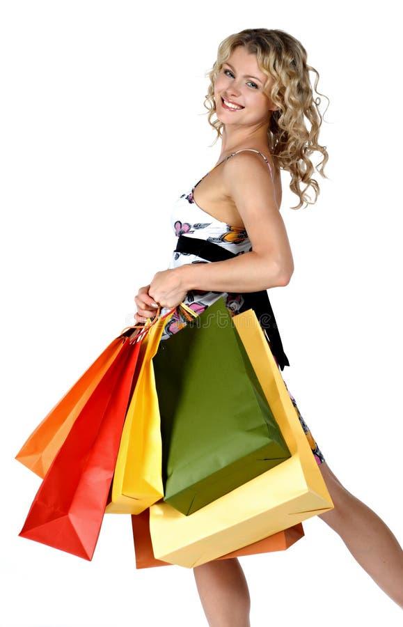 Kaufende reizvolle Frau lizenzfreie stockfotos