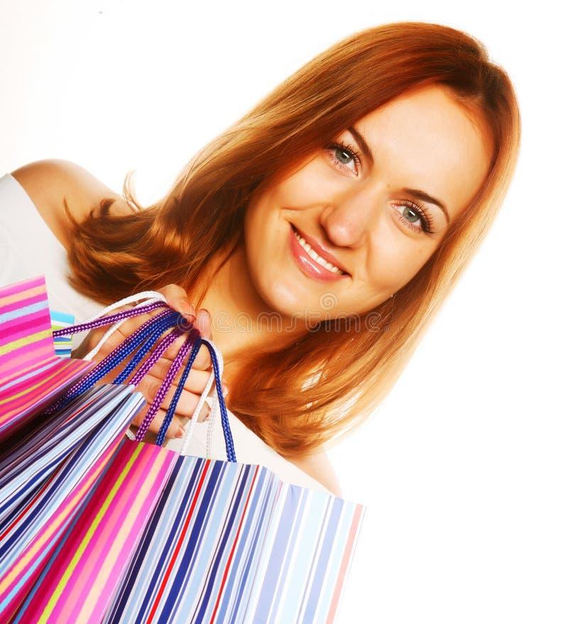 Kaufende reizvolle Frau stockfoto