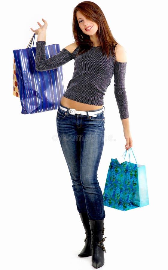 Kaufende reizvolle junge Frau stockbilder