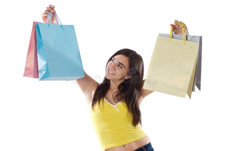 Kaufendes junges Mädchen lizenzfreies stockbild