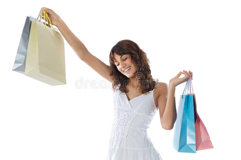 Kaufendes junges Mädchen lizenzfreie stockbilder
