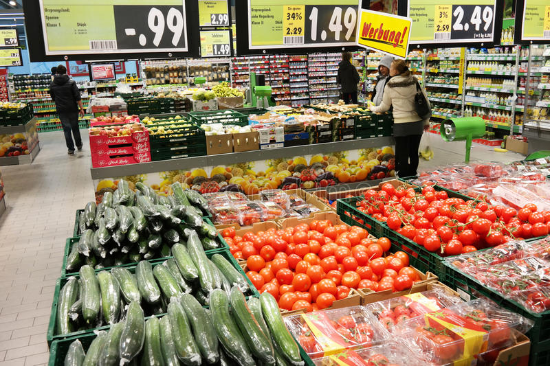 Kaufland Hypermarket. MEPPEN, GERMANY - FEBRUARY 2015: Fruits and vegetables on the fresh department of a Kaufland supermarket. Kaufland is a German hypermarket stock photography