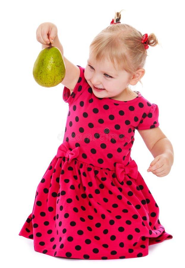 Kaukasisch blond meisje in een rode stip stock fotografie