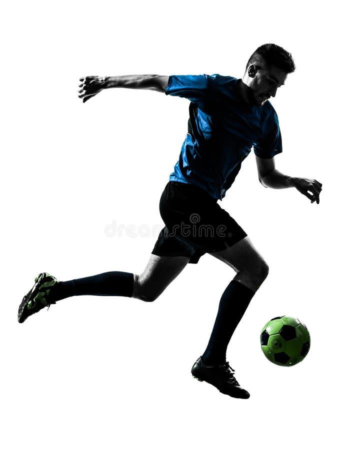 Kaukasisch voetballermens het jongleren met silhouet stock foto