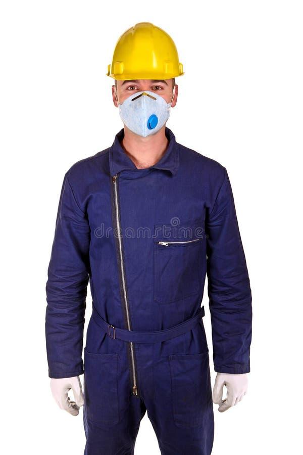 Kaukasische Arbeitskraft mit Schutzkleidung stockbilder