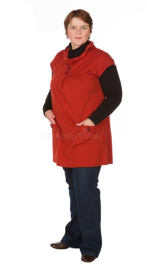 Kaukasische vrouw in sinaasappel en blauw stock foto's