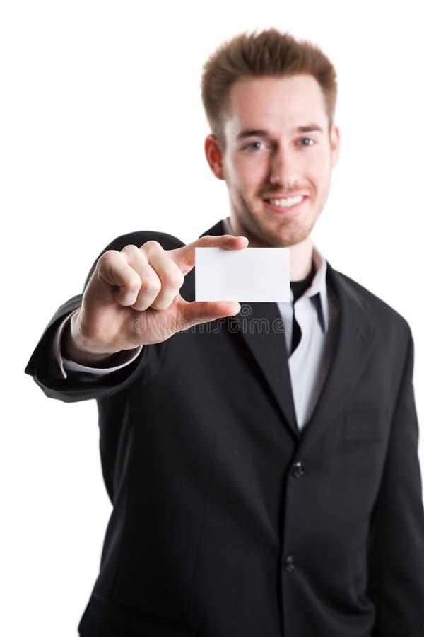 Kaukasischer Geschäftsmann und Visitenkarte lizenzfreie stockfotos