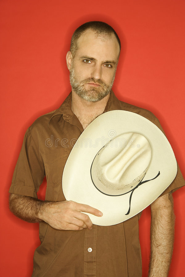 Kaukasischer Mann mit Cowboyhut. lizenzfreies stockbild