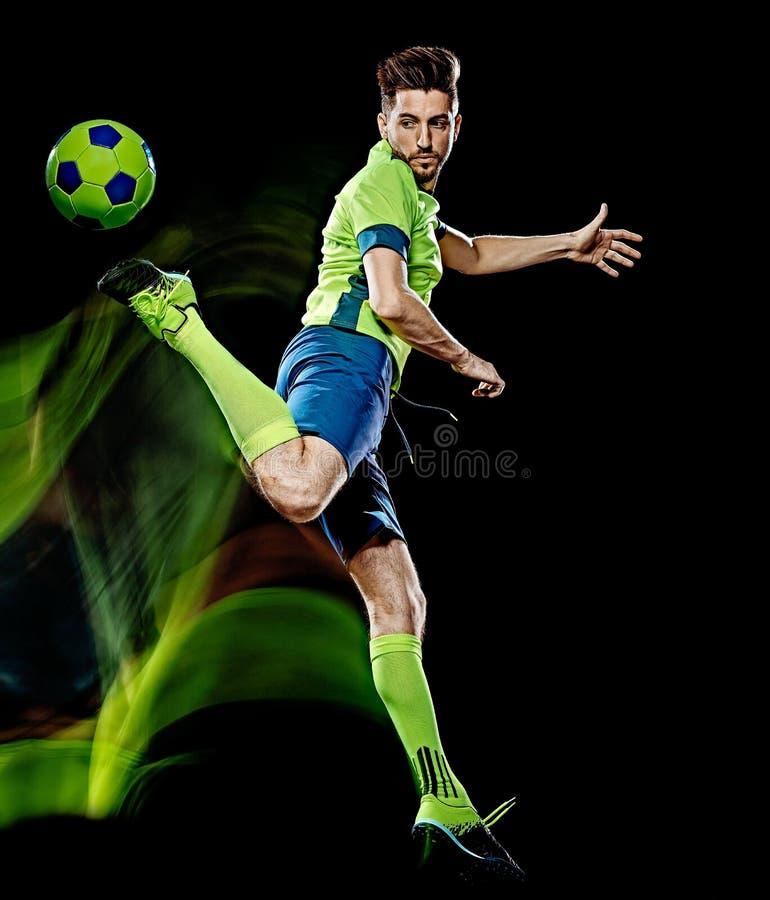 Kaukaski gracz piłki nożnej mężczyzna odizolowywał czarnego tła światła obraz zdjęcie stock