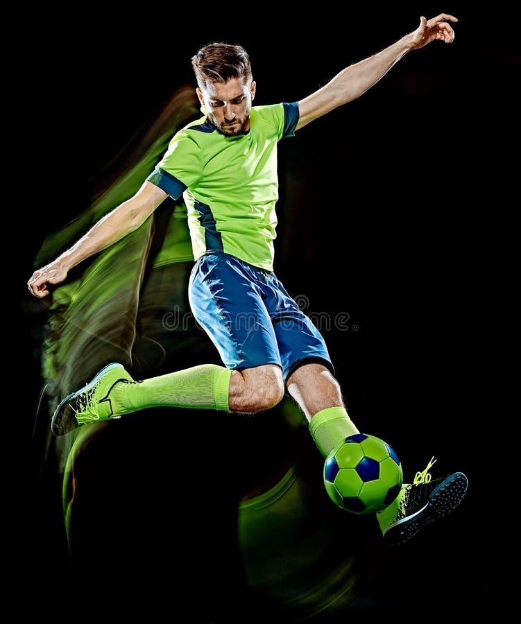 Kaukaski gracz piłki nożnej mężczyzna odizolowywał czarnego tła światła obraz zdjęcia royalty free