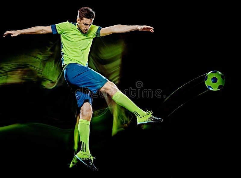 Kaukaski gracz piłki nożnej mężczyzna odizolowywał czarnego tła światła obraz obraz stock