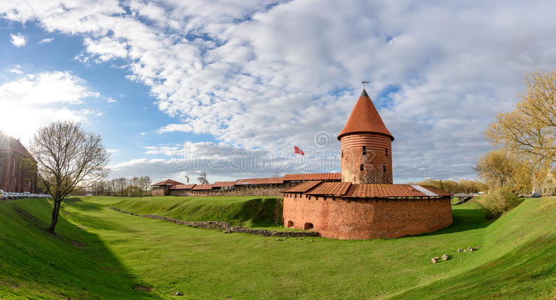 Kaunas Castle, Lithuania. Historical gothic Kaunas Castle from medieval times in Kaunas, Lithuania. Wide angle panoramic view on cloudy sky background stock photography