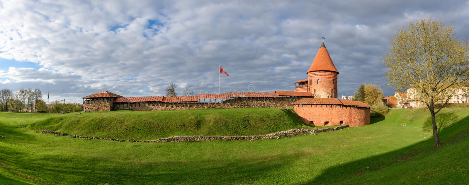Kaunas Castle, Lithuania. Historical gothic Kaunas Castle from medieval times in Kaunas, Lithuania. Wide angle panoramic view on cloudy sky background stock image