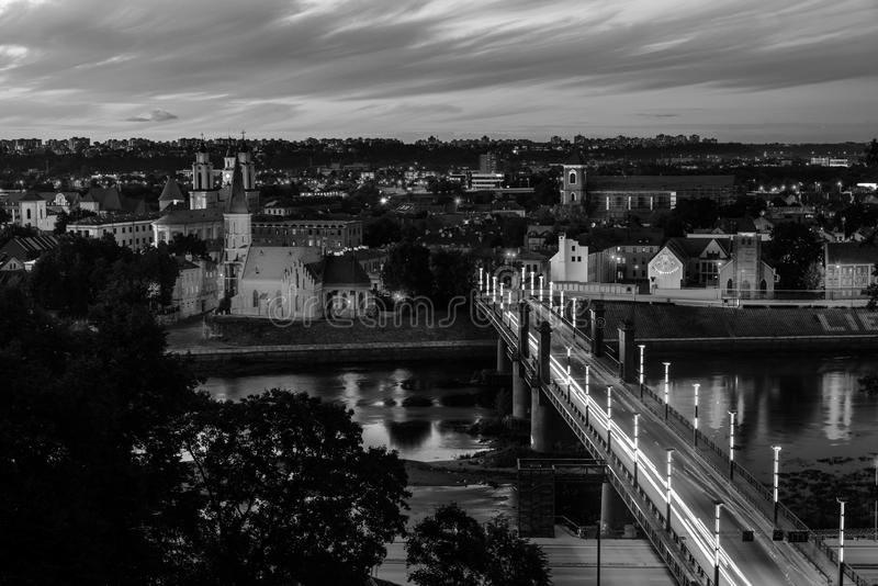 Aerial view of famous city Kaunas, Lithuania at sunset. Night view. Black and white. Kaunas, Lithuania. Aerial view of famous city Kaunas, Lithuania at sunset royalty free stock photos