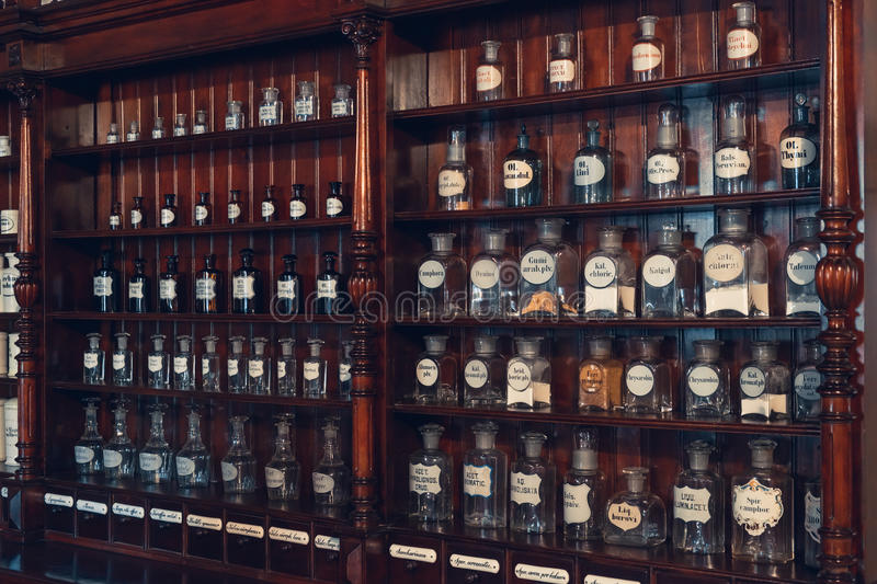 Kaunas, Lithuania - May 12, 2017: cabinet of drugs in Museum of Medicine. Kaunas, Lithuania - May 12, 2017: shelf of vials with retro drugs in old apothecary royalty free stock image