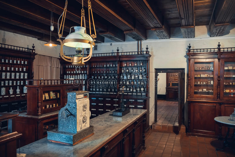 Kaunas, Lithuania - May 12, 2017: Interior of old pharmacy in Museum of Medicine. Kaunas, Lithuania - May 12, 2017: Interior of old pharmacy: shelfs with drugs royalty free stock image