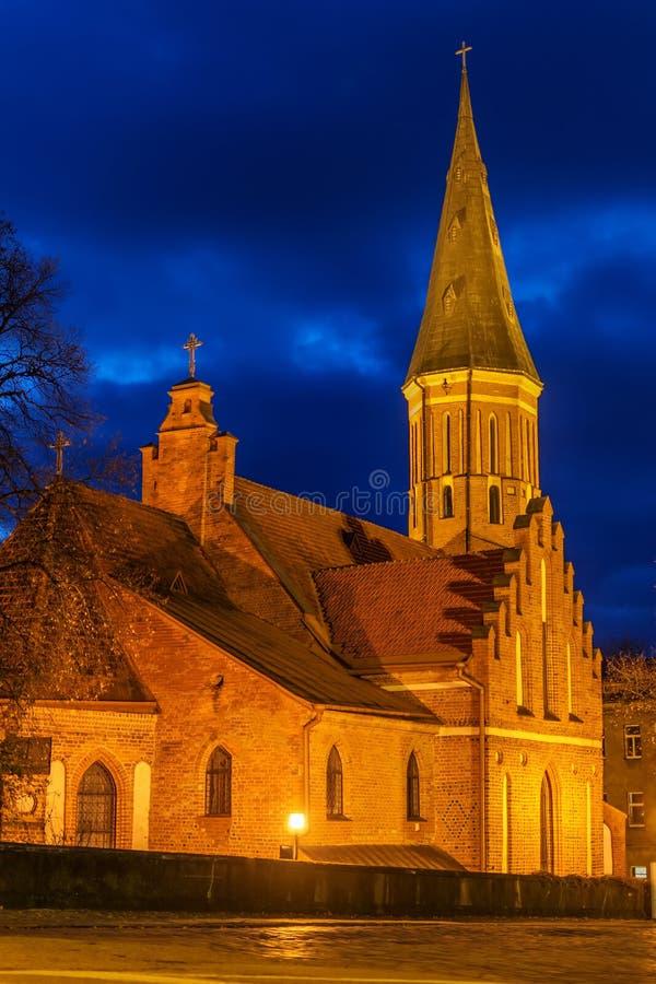 Kaunas, Litouwen: De Grote Kerk van Vytautas bij nacht royalty-vrije stock foto