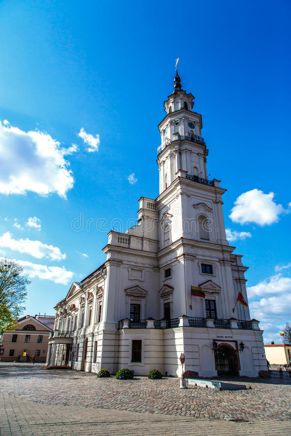 Kaunas Town Hall. Front view of Town Hall building in town hall square of Kaunas old town, Lithuania, built in 16th century, on cloudy blue sky background stock photo