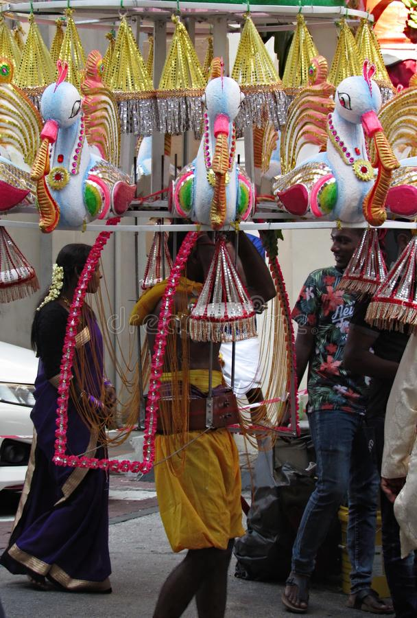 Kavadi Bearer. A kavadi bearer passing by Ipoh old-town during the 2018 Thaipusam celebrations royalty free stock images