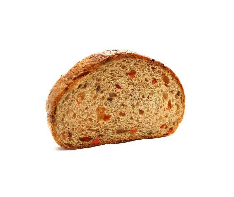 Kawałek zbożowego chleba rżnięty owal odizolowywający na bielu obraz stock