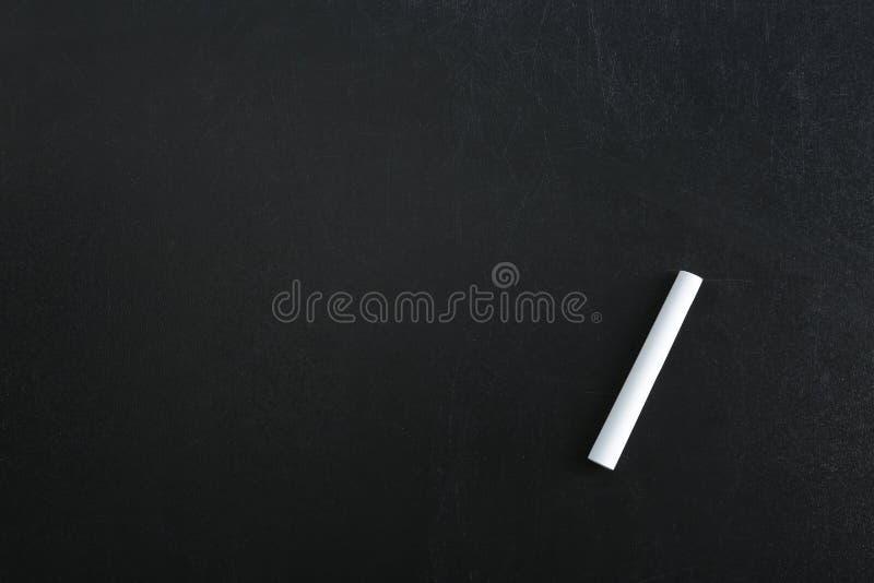 Kawałek kreda na blackboard obraz stock