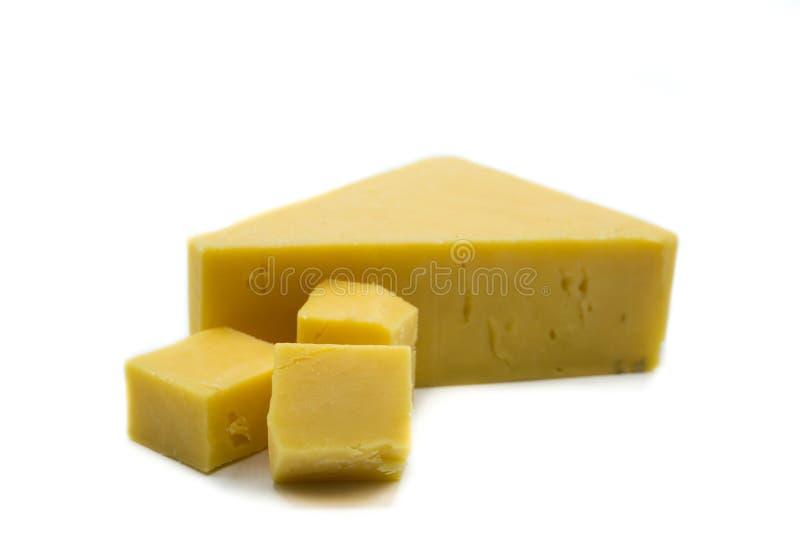 Kawałek odizolowywający na białym tle cheddaru ser zdjęcie royalty free