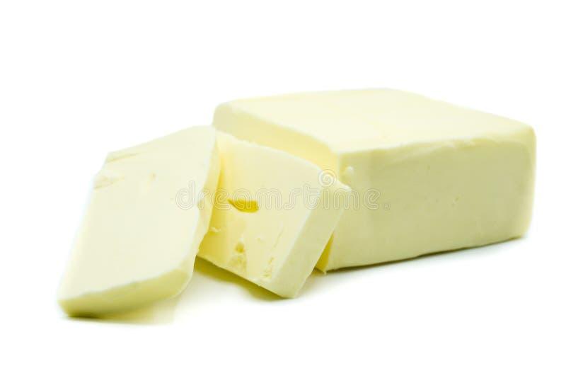 Kawałek odizolowywający na białym tle masło zdjęcie royalty free