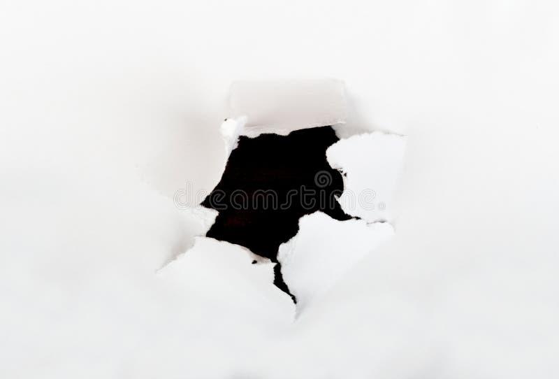 Kawałek papieru z dziurą w centrum zdjęcia royalty free
