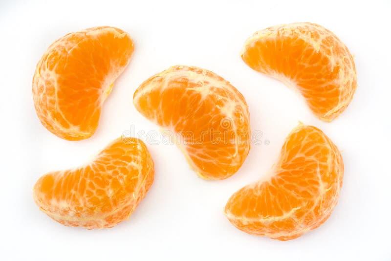 Kawałka tangerine odizolowywający na białym tle fotografia stock