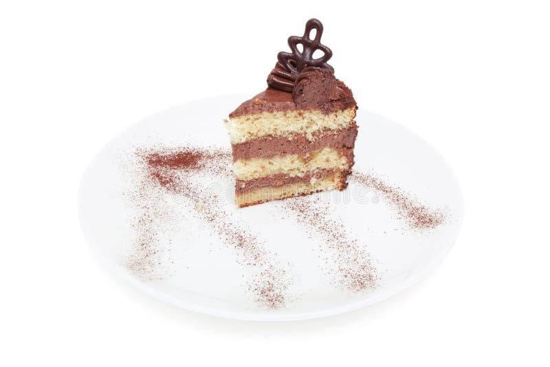 kawałka tortowy czekoladowy kremowy talerz fotografia royalty free