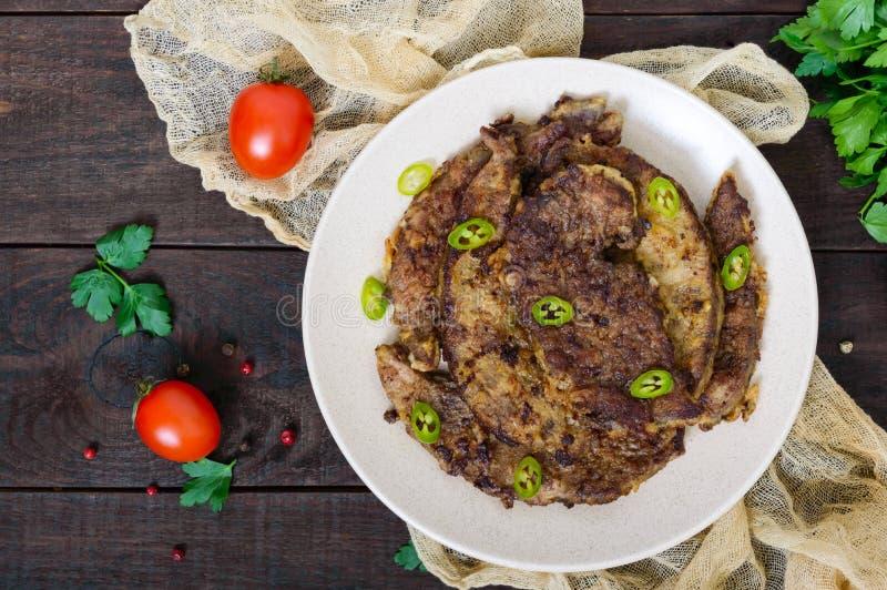 Kawałki smażąca wieprzowiny wątróbka na talerzu zdjęcia stock