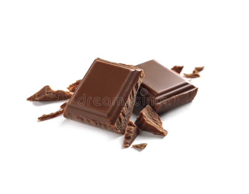 Kawałki smakowita dojna czekolada na bielu obraz royalty free