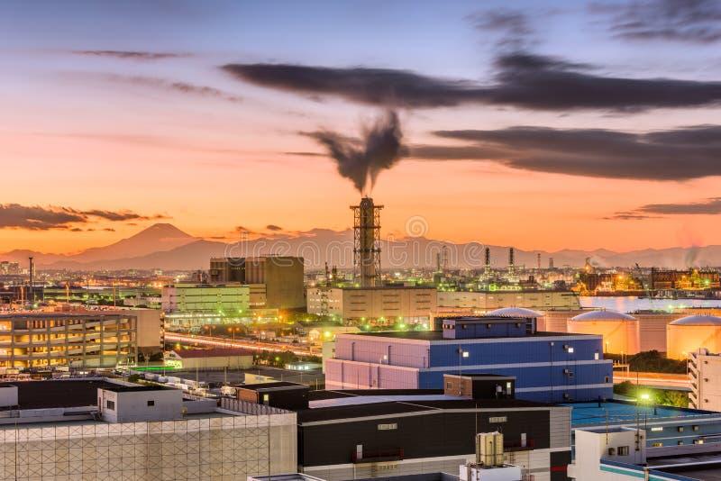 Kawasaki, Japan factories and Mt. Fuji. At dusk stock photo