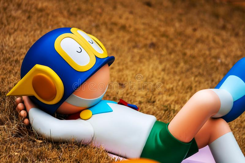 KAWASAKI, JAPAN - March 19, 2014: Fujiko F Fujio Museum, Parman lies down sculpture at outdoor rooftop playground zone. Close up Parman in blurry background royalty free stock image