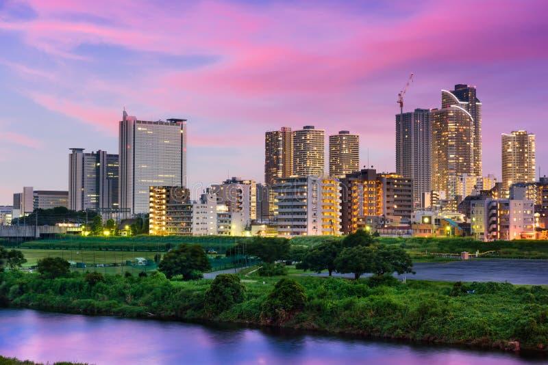 Kawasaki, Japan Skyline. On the Tamagawa river royalty free stock photos