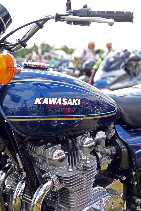 Kawasaki Z900 vintage motorcycle petrol tank and engine with refections. Laverda 1000 in reflection royalty free stock image