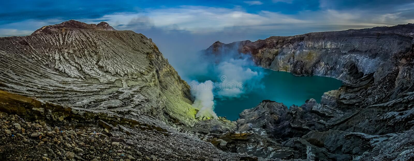 KAWEH IJEN, INDONESIA: Spectacular overview of volcanic crater lake with rough mountain cliffs, great nature concept royalty free stock photography