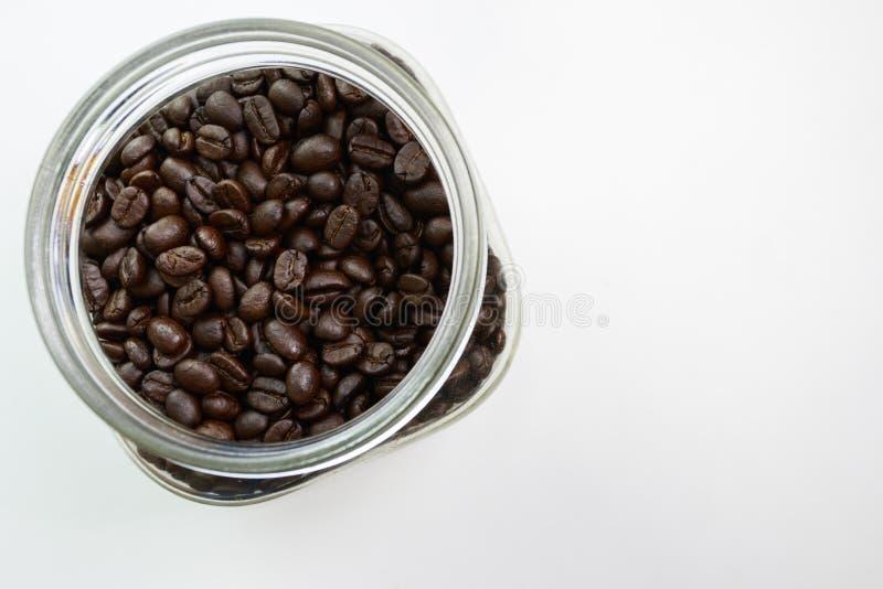 Kawowa fasola na szkle obraz stock