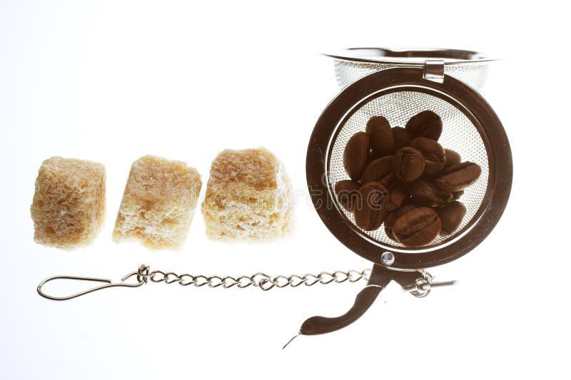 Kawowe fasole i cukier zdjęcia royalty free