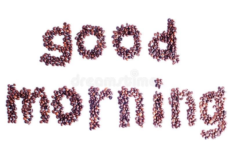 Kawowe fasole kłaść out w postaci słowo dnia dobrego odizolowywającego fotografia stock