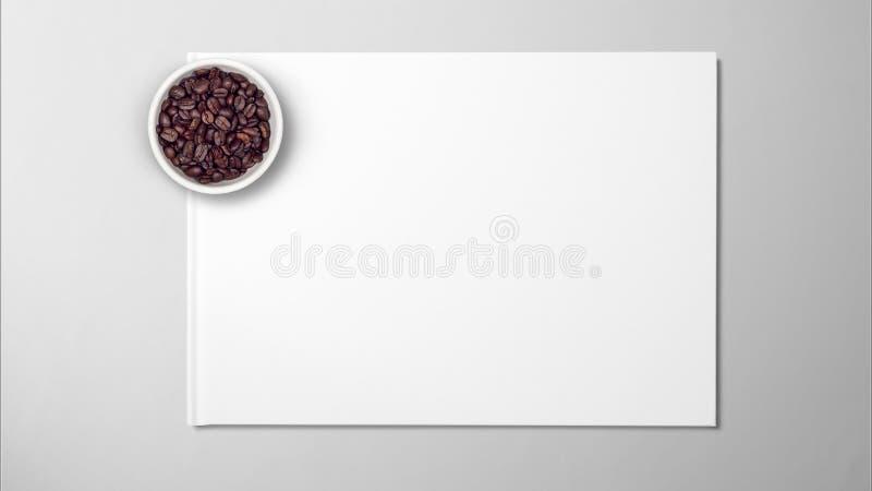 Kawowe fasole w pucharze na białej księdze na czystym tle zdjęcie royalty free