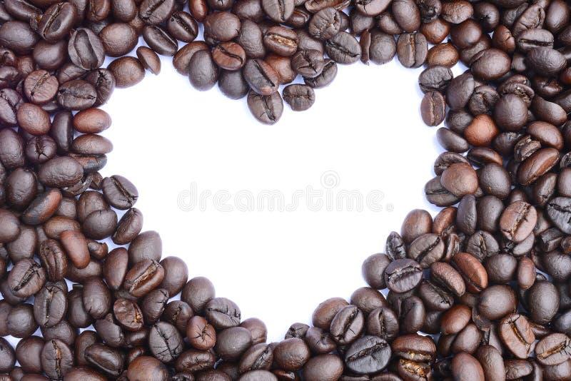 Kawowych fasoli zakończenia serce obraz royalty free