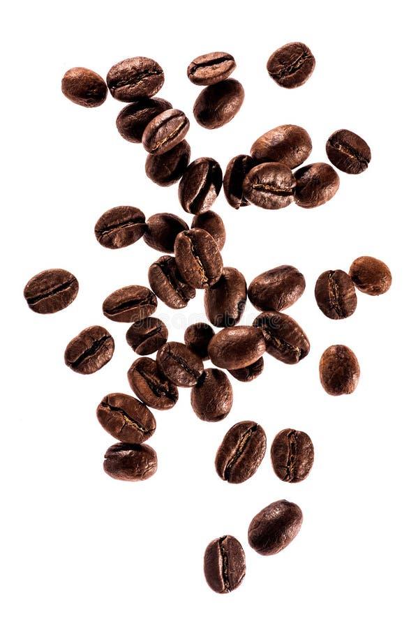 Kawowych fasoli zamknięty up odizolowywający zdjęcie stock