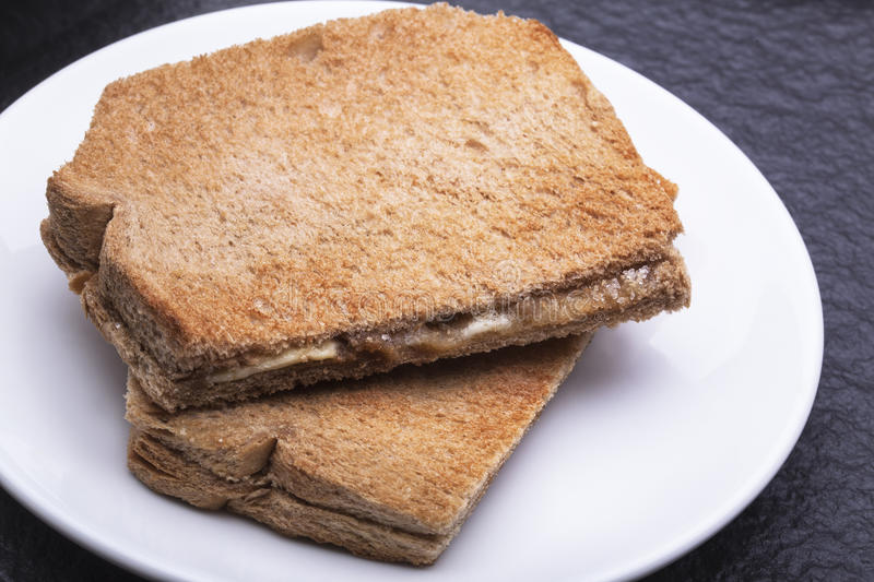 Kaya Toast (Asia Snack) on the white dish and table. stock photography