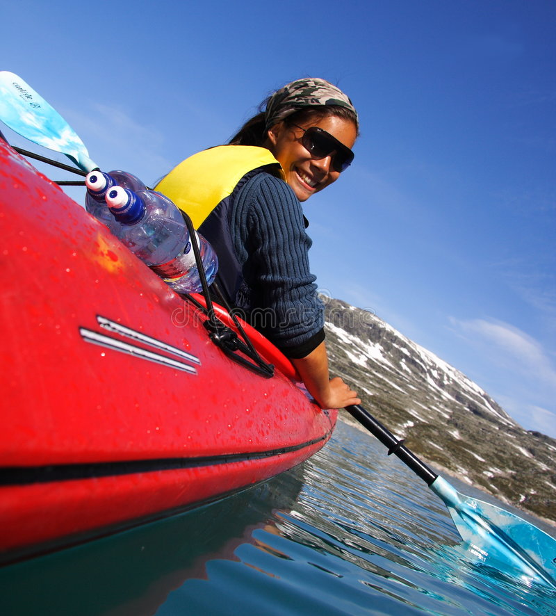 Kayak. Ing at glacier lake at Jostedalsbreen, Norway. I have more  pictures like this in my portfolio