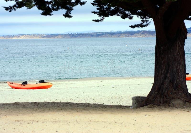 Kayak on a beach stock photography